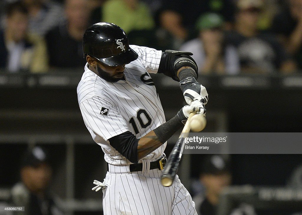 <a gi-track='captionPersonalityLinkClicked' href=/galleries/search?phrase=Alexei+Ramirez&family=editorial&specificpeople=690568 ng-click='$event.stopPropagation()'>Alexei Ramirez</a> #10 of the Chicago White Sox connects on and RBI single scoring teammate Jose Abreu during the eighth inning against the Minnesota Twins at U.S. Cellular Field on August 1, 2014 in Chicago, Illinois.