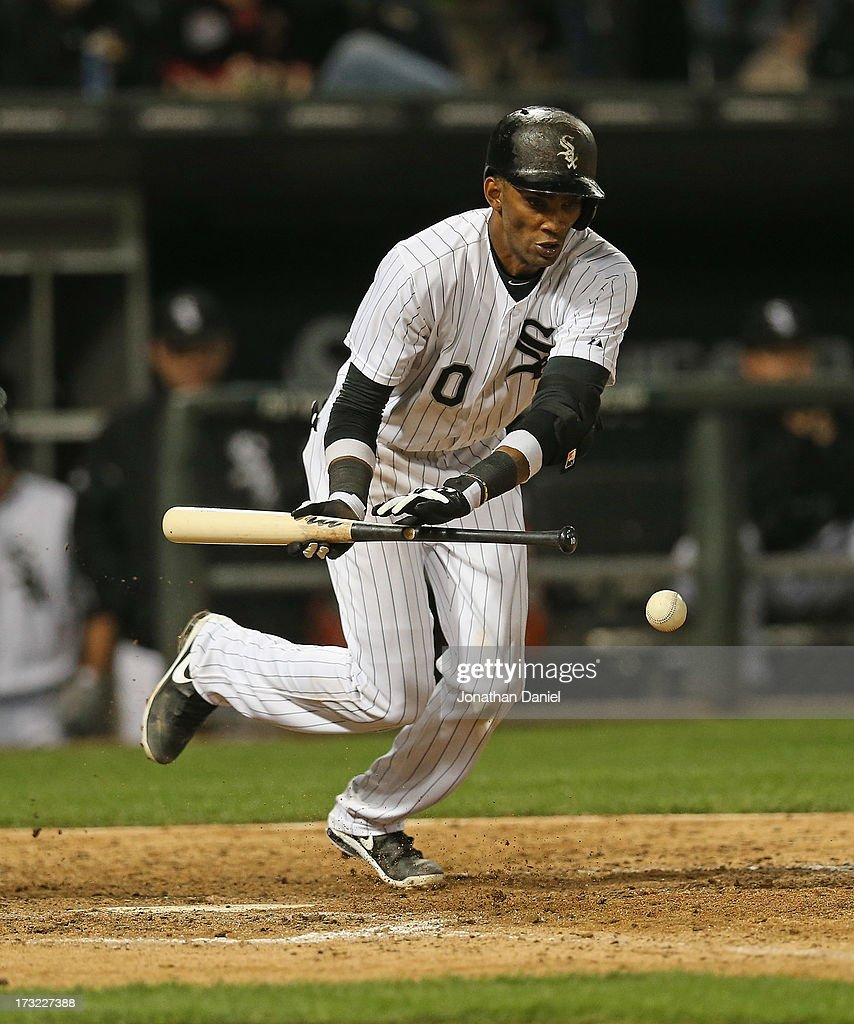 <a gi-track='captionPersonalityLinkClicked' href=/galleries/search?phrase=Alexei+Ramirez&family=editorial&specificpeople=690568 ng-click='$event.stopPropagation()'>Alexei Ramirez</a> #10 of the Chicago White Sox excecutes a bunt against the Oakland Athletics at U.S. Cellular Field on June 6, 2013 in Chicago, Illinois. The Athletics defeated the White Sox 5-4 in 10 innings.