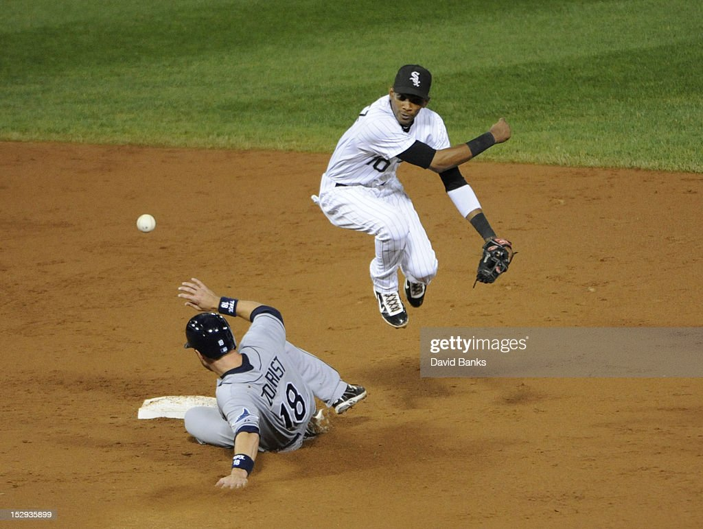 <a gi-track='captionPersonalityLinkClicked' href=/galleries/search?phrase=Alexei+Ramirez&family=editorial&specificpeople=690568 ng-click='$event.stopPropagation()'>Alexei Ramirez</a> #10 of the Chicago White Sox forces out <a gi-track='captionPersonalityLinkClicked' href=/galleries/search?phrase=Ben+Zobrist&family=editorial&specificpeople=2120037 ng-click='$event.stopPropagation()'>Ben Zobrist</a> #18 of the Tampa Bay Rays in the third inning on September 28, 2012 at U.S. Cellular Field in Chicago, Illinois.