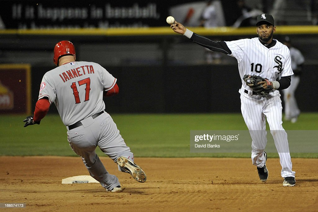 <a gi-track='captionPersonalityLinkClicked' href=/galleries/search?phrase=Alexei+Ramirez&family=editorial&specificpeople=690568 ng-click='$event.stopPropagation()'>Alexei Ramirez</a> #10 of the Chicago White Sox forces out <a gi-track='captionPersonalityLinkClicked' href=/galleries/search?phrase=Chris+Iannetta&family=editorial&specificpeople=836137 ng-click='$event.stopPropagation()'>Chris Iannetta</a> #17 of the Los Angeles Angels of Anaheim during the seventh inning on May 11, 2013 at U.S. Cellular Field in Chicago, Illinois.
