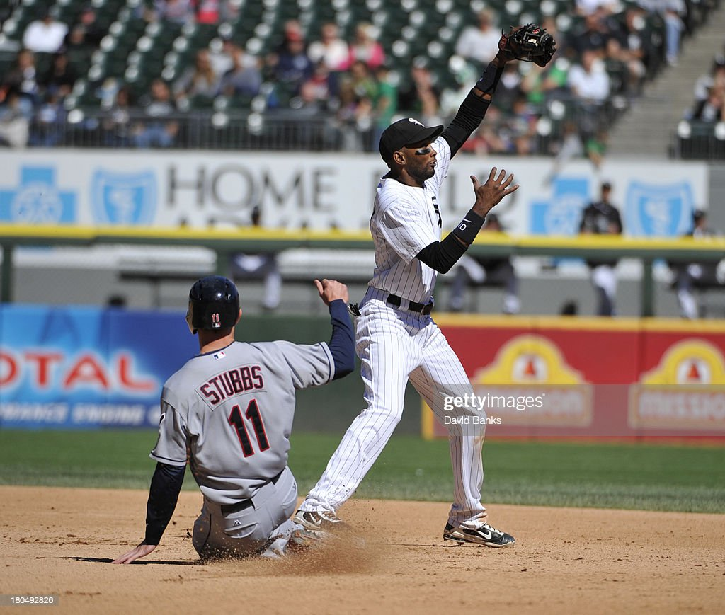 <a gi-track='captionPersonalityLinkClicked' href=/galleries/search?phrase=Alexei+Ramirez&family=editorial&specificpeople=690568 ng-click='$event.stopPropagation()'>Alexei Ramirez</a> #10 of the Chicago White Sox forces out <a gi-track='captionPersonalityLinkClicked' href=/galleries/search?phrase=Drew+Stubbs+-+Baseball+Player&family=editorial&specificpeople=4498334 ng-click='$event.stopPropagation()'>Drew Stubbs</a> #11 of the Cleveland Indians during the fourth inning on September 13, 2013 at U.S. Cellular Field in Chicago, Illinois.