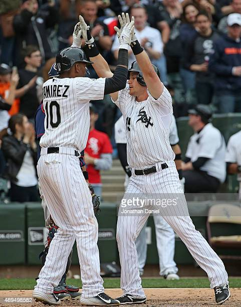 Alexei Ramirez of the Chicago White Sox high fives teammate Gordon Beckham after Beckham hit a two run home run in the8th inning against the...