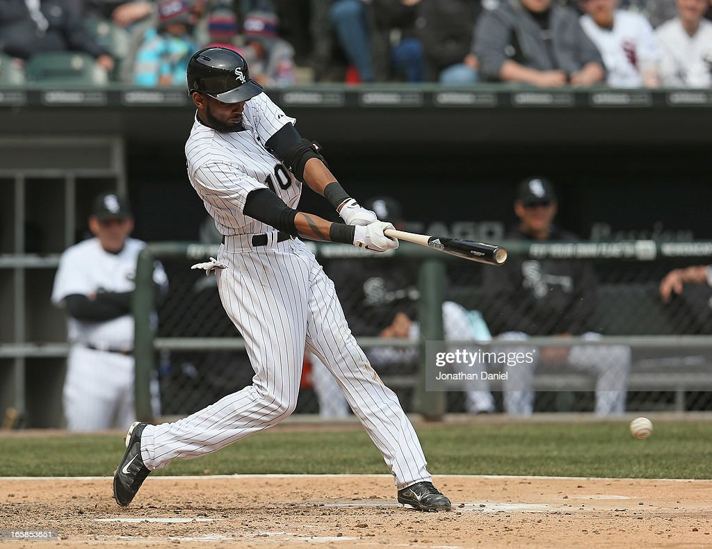 Alexei Ramirez #10 of the Chicago White Sox hits a double in the 7th inning against the Seattle Mariners at U.S. Cellular Field on April 6, 2013 in Chicago, Illinois. The White Sox defeated the Mariners 4-3.