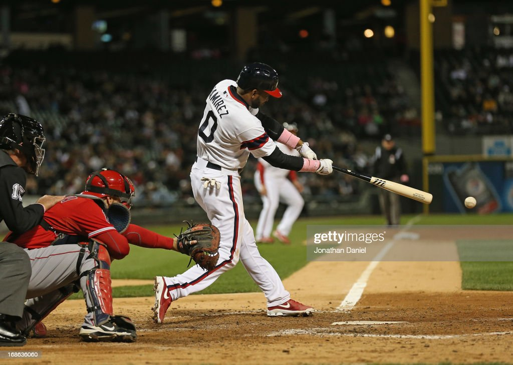 <a gi-track='captionPersonalityLinkClicked' href=/galleries/search?phrase=Alexei+Ramirez&family=editorial&specificpeople=690568 ng-click='$event.stopPropagation()'>Alexei Ramirez</a> #10 of the Chicago White Sox hits a run scoring single in the 7th inning against the Los Angeles Angels of Anaheim at U.S. Cellular Field on May 12, 2013 in Chicago, Illinois.