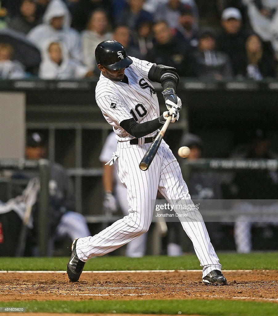 Alexei Ramirez #10 of the Chicago White Sox hits a two-run single in the 4th inning against the Los Angeles Angels of Anaheim at U.S. Cellular Field on July 2, 2014 in Chicago, Illinois.