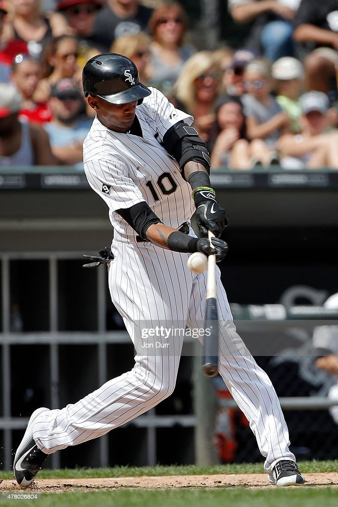 Alexei Ramirez #10 of the Chicago White Sox hits an RBI single against the Texas Rangers during the sixth inning at U.S. Cellular Field on June 21, 2015 in Chicago, Illinois. The Chicago White Sox won 3-2 in eleven innings