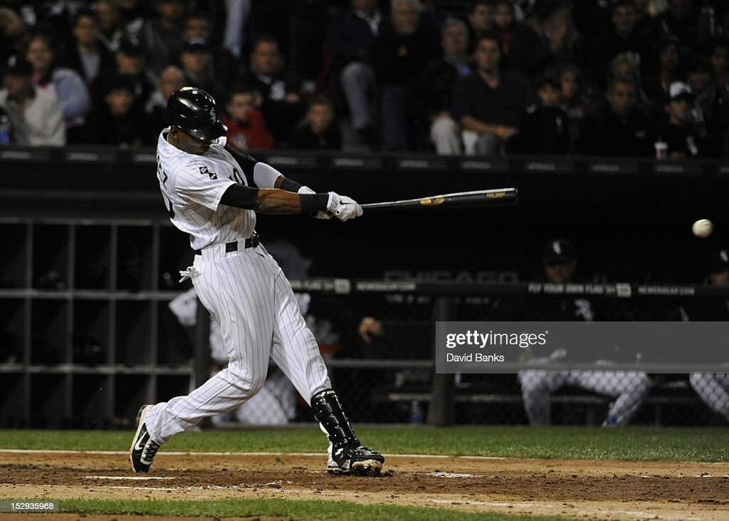 <a gi-track='captionPersonalityLinkClicked' href=/galleries/search?phrase=Alexei+Ramirez&family=editorial&specificpeople=690568 ng-click='$event.stopPropagation()'>Alexei Ramirez</a> #10 of the Chicago White Sox hits an RBI single in the sixth inning against the Tampa Bay Rays on September 28, 2012 at U.S. Cellular Field in Chicago, Illinois.