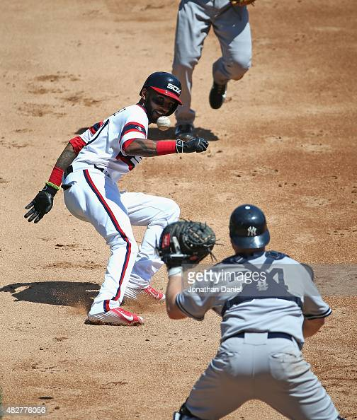 Alexei Ramirez of the Chicago White Sox is caught in a rundown as Brian McCann of the New York Yankees takes the throw in the 2nd inning at US...