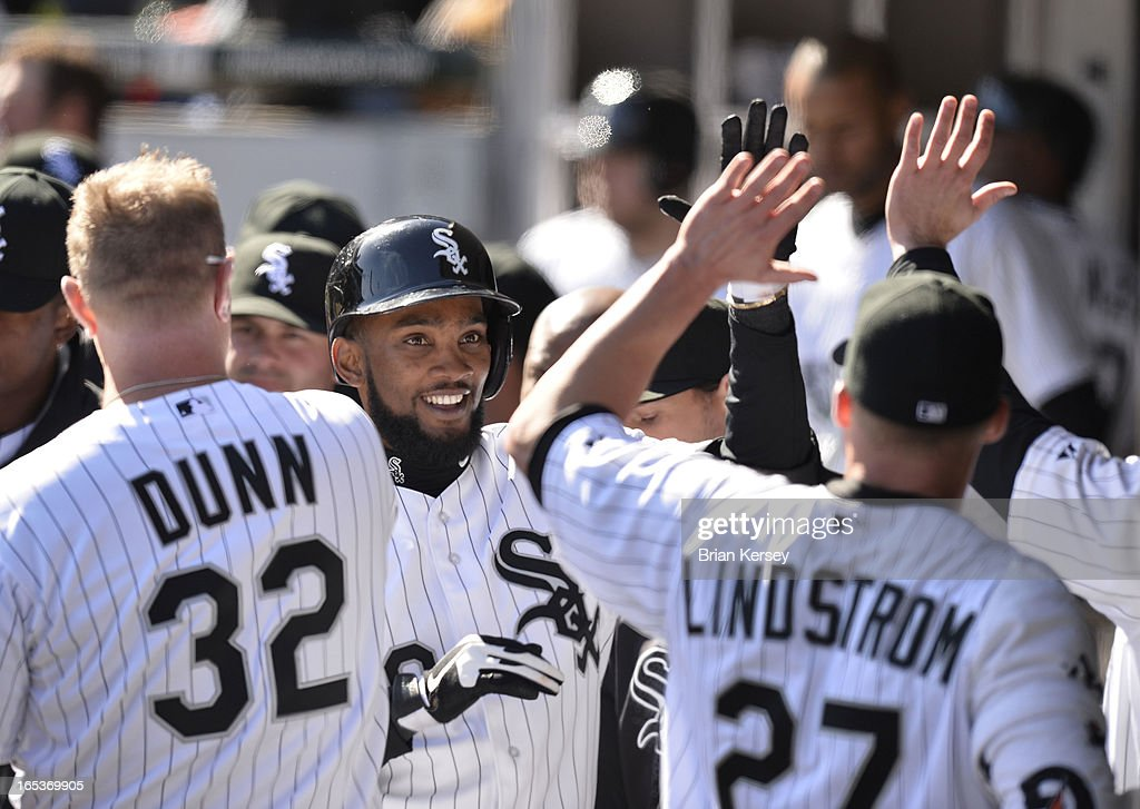 Alexei Ramirez #10 of the Chicago White Sox (C) is congratulated in the dugout after hitting a solo home run during the seventh inning against the Kansas City Royals on April 3, 2012 at U.S. Cellular Field in Chicago, Illinois.