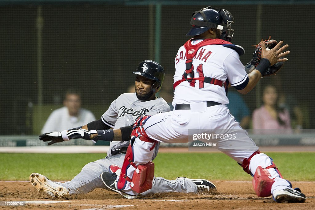 Alexei Ramirez #10 of the Chicago White Sox is safe at home off a single by Alex Rios #51 as catcher Carlos Santana #41 of the Cleveland Indians catches the late throw during the sixth inning at Progressive Field on July 31, 2013 in Cleveland, Ohio.