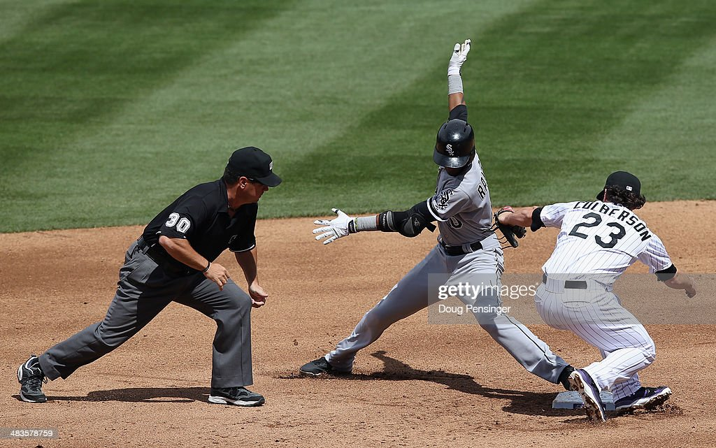 Alexei Ramirez of the Chicago White Sox is safe at second base as second baseman Charlie Culberson of the Colorado Rockies takes the late throw and...