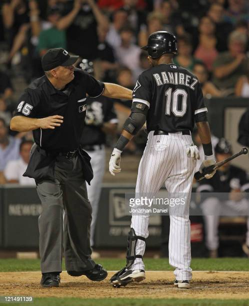 Alexei Ramirez of the Chicago White Sox is thrown out of a game against the Texas Rangers by home plate umpire Jeff Nelson after arguing a called...