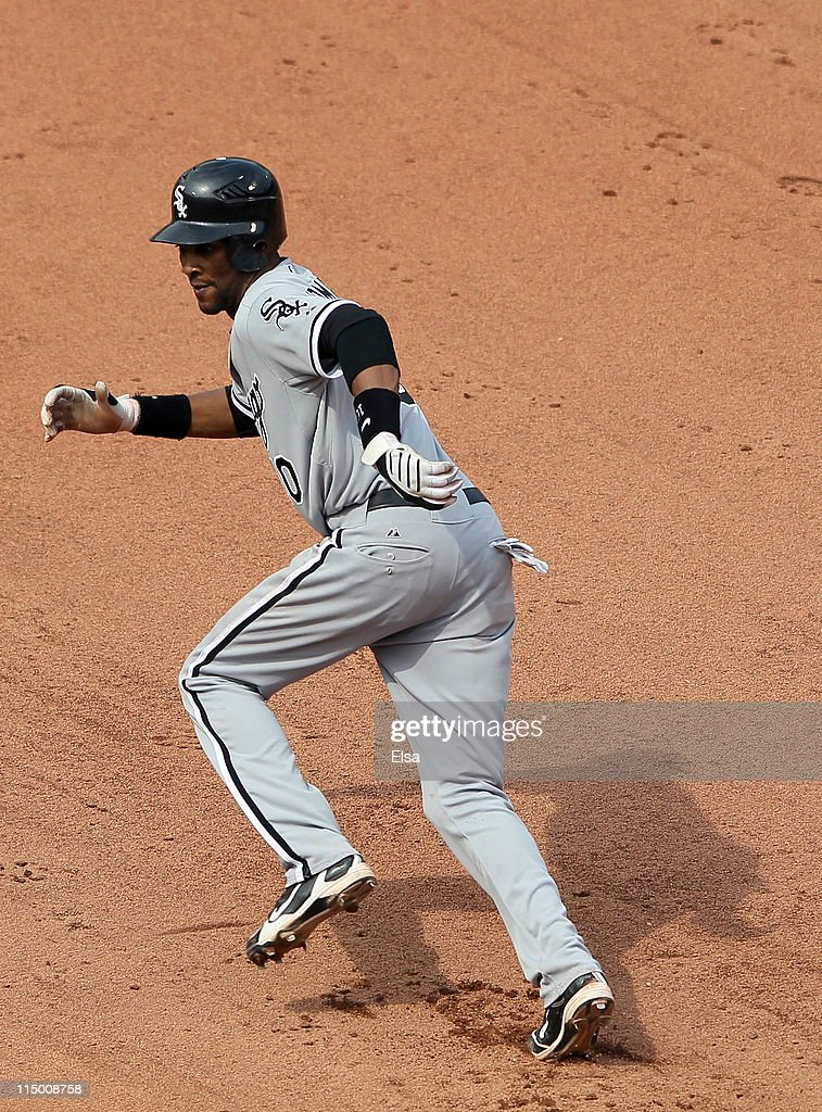 <a gi-track='captionPersonalityLinkClicked' href=/galleries/search?phrase=Alexei+Ramirez&family=editorial&specificpeople=690568 ng-click='$event.stopPropagation()'>Alexei Ramirez</a> #10 of the Chicago White Sox leads off first base and later scores the game winning run against the Boston Red Sox on June 1, 2011 at Fenway Park in Boston, Massachusetts.