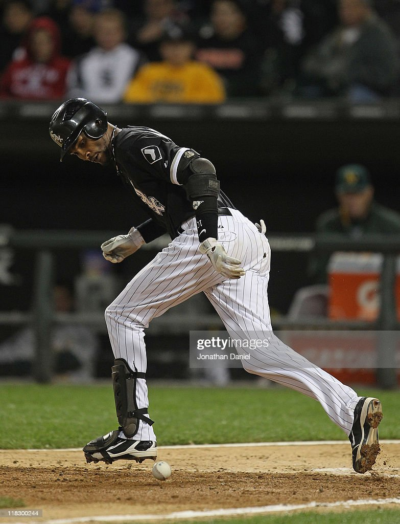 <a gi-track='captionPersonalityLinkClicked' href=/galleries/search?phrase=Alexei+Ramirez&family=editorial&specificpeople=690568 ng-click='$event.stopPropagation()'>Alexei Ramirez</a> #10 of the Chicago White Sox looks down at the ball he bunted against the Oakland Athletics at U.S. Cellular Field on June 9, 2011 in Chicago, Illinois. The White Sox defeated the Athletics 9-4.