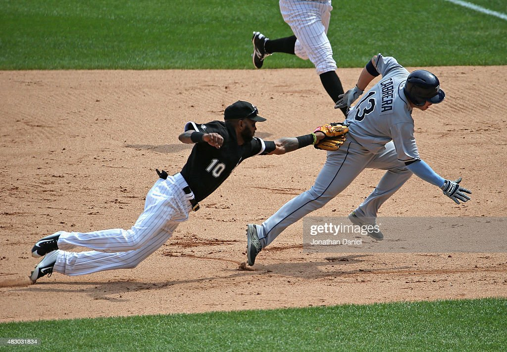Alexei Ramirez #10 of the Chicago White Sox lunges to tag out Asdrubal Cabrera #13 of the Tampa Bay Rays on a run-down in the 7th inning at U.S. Cellular Field on August 5, 2015 in Chicago, Illinois.