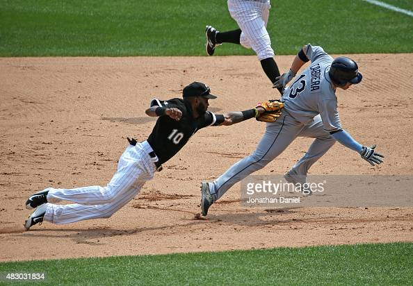 Alexei Ramirez of the Chicago White Sox lunges to tag out Asdrubal Cabrera of the Tampa Bay Rays on a rundown in the 7th inning at US Cellular Field...