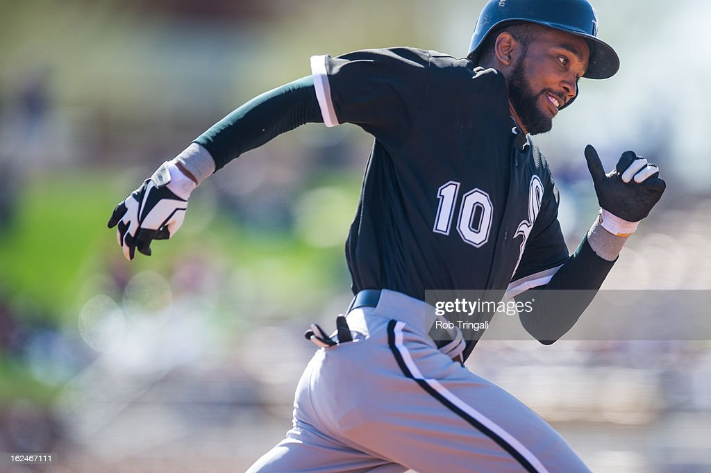 Alexei Ramirez #10 of the Chicago White Sox rounds third base before scoring in the second inning during a spring training game against the Los Angeles Dodgers at Camelback Ranch on February 23, 2013 in Glendale, Arizona.