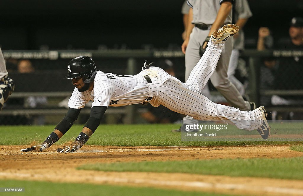 <a gi-track='captionPersonalityLinkClicked' href=/galleries/search?phrase=Alexei+Ramirez&family=editorial&specificpeople=690568 ng-click='$event.stopPropagation()'>Alexei Ramirez</a> #10 of the Chicago White Sox scores the game-winning run in the 12 inning against the New York Yankees at U.S. Cellular Field on August 7, 2013 in Chicago, Illinois. The White Sox defeated the Yankees 6-5 in 12 innings.