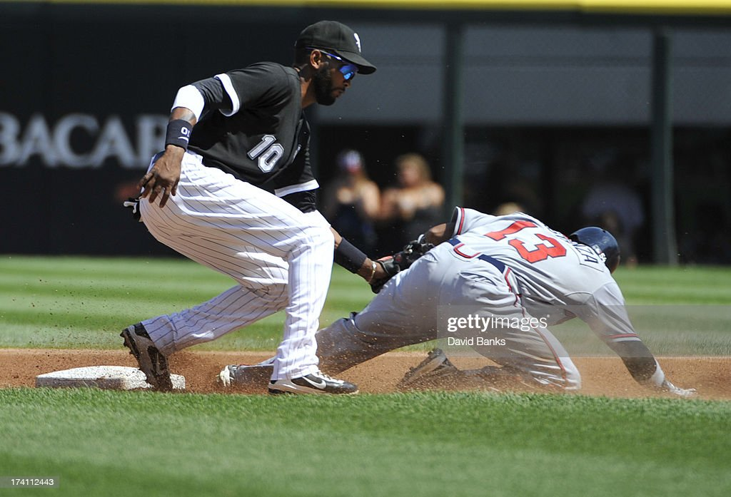 Alexei Ramirez #10 of the Chicago White Sox tags out Jose Constanza #13 of the Atlanta Braves on a steal attempt during the first inning on July 20, 2013 at U.S. Cellular Field in Chicago, Illinois.