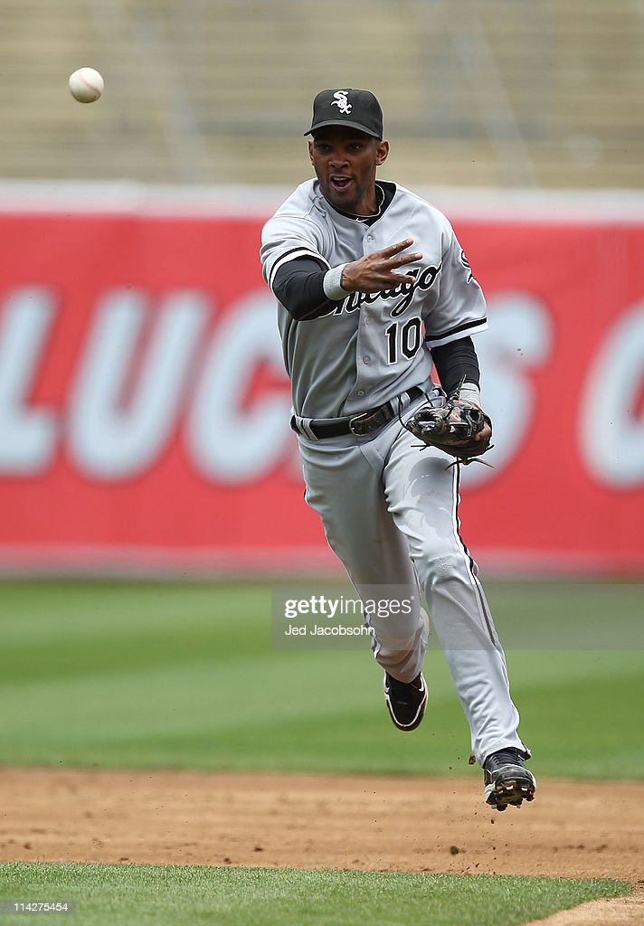<a gi-track='captionPersonalityLinkClicked' href=/galleries/search?phrase=Alexei+Ramirez&family=editorial&specificpeople=690568 ng-click='$event.stopPropagation()'>Alexei Ramirez</a> #10 of the Chicago White Sox throws to first against the Oakland Athletics during a Major League Baseball game at the Oakland-Alameda County Coliseum on May 14, 2011 in Oakland, California.