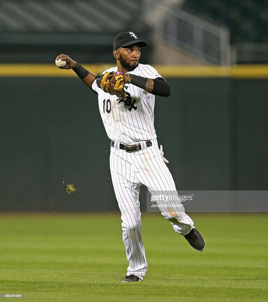 Alexei Ramirez #10 of the Chicago White Sox throws to first base for the second half of a double play in the 9th inning against the Chicago Cubs at U.S. Cellular Field on May 7, 2014 in Chicago, Illinois. The White Sox defeated the Cubs 8-3.
