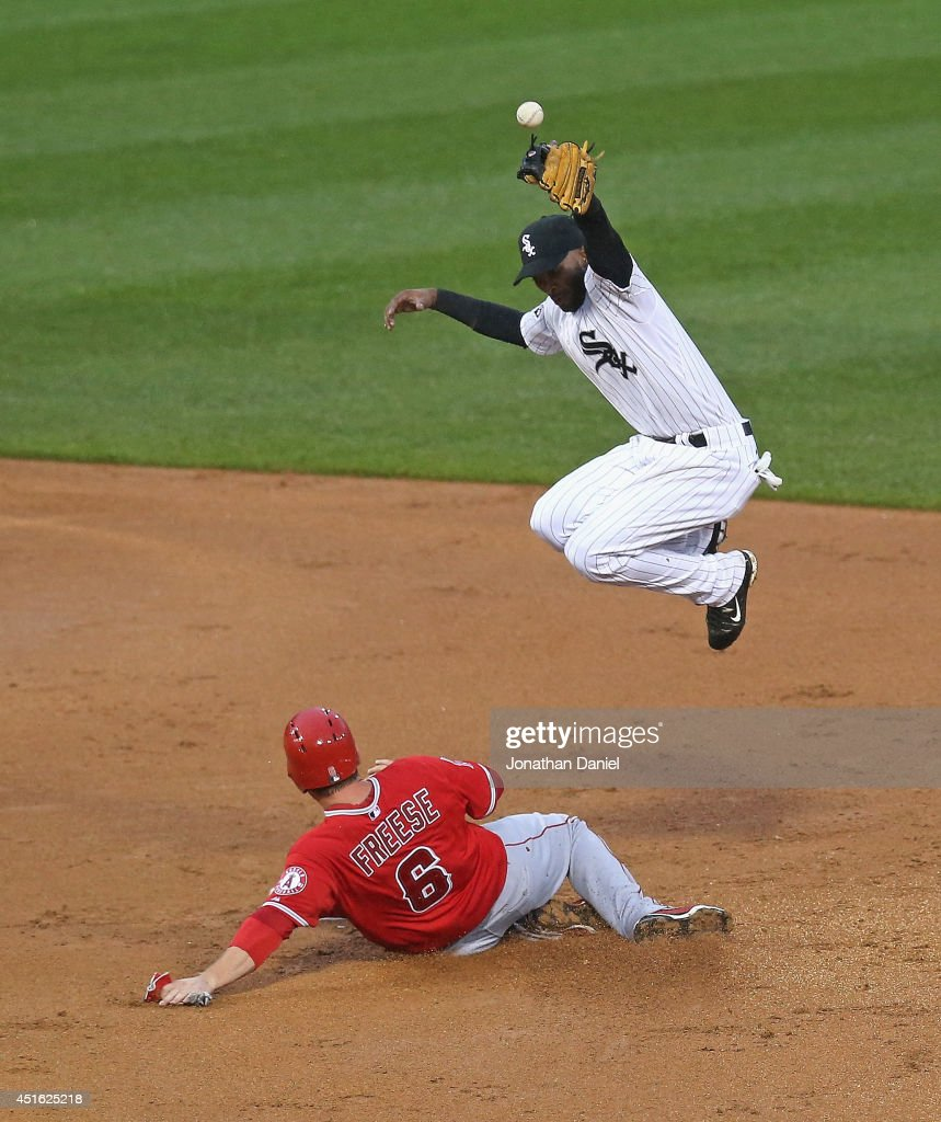 <a gi-track='captionPersonalityLinkClicked' href=/galleries/search?phrase=Alexei+Ramirez&family=editorial&specificpeople=690568 ng-click='$event.stopPropagation()'>Alexei Ramirez</a> #10 of the Chicago White Sox tries to reach the ball as <a gi-track='captionPersonalityLinkClicked' href=/galleries/search?phrase=David+Freese+-+Baseball+Player&family=editorial&specificpeople=4948315 ng-click='$event.stopPropagation()'>David Freese</a> #6 of the Los Angeles Angels of Anaheim slides safely into second base in the 2nd innng at U.S. Cellular Field on July 2, 2014 in Chicago, Illinois.