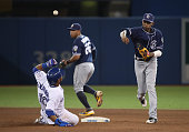 Alexei Ramirez of the San Diego Padres cannot turn the double play as he gets the force out of Edwin Encarnacion of the Toronto Blue Jays at second...