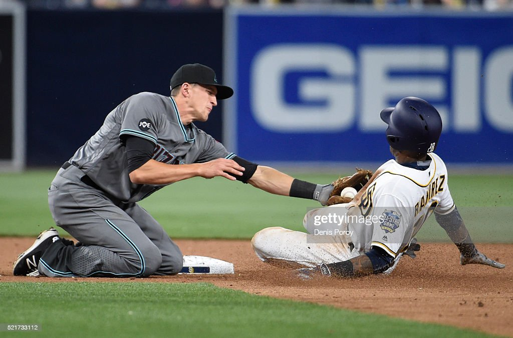 Alexei Ramirez #10 of the San Diego Padres is tagged out by Nick Ahmed #13 of the Arizona Diamondbacks as he tries to steal second base during the ninth inning of a baseball game at PETCO Park on April 16, 2016 in San Diego, California.
