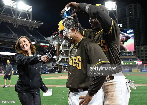 Alexei Ramirez of the San Diego Padres right pours water on the head of Jon Jay after the Padres beat the New York Mets 20 in a baseball game at...
