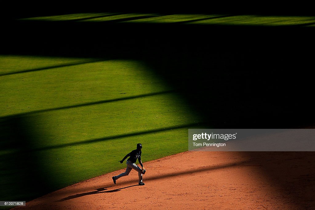 Alexei Ramirez #24 of the Tampa Bay Rays moves to the ball against the Texas Rangers in the bottom of the eighth inning at Globe Life Park in Arlington on October 2, 2016 in Arlington, Texas.