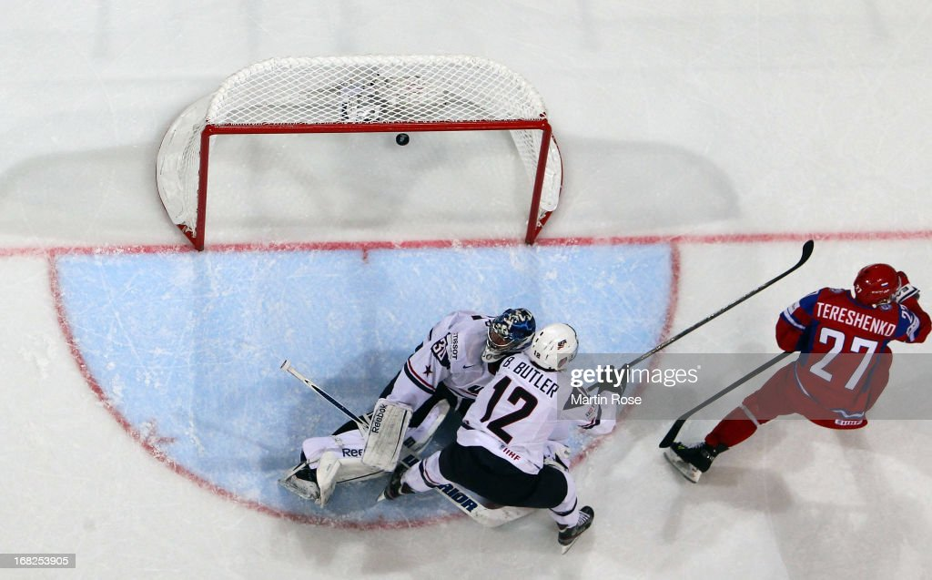 Alexei Tereshenko of Russia scores his team's 3rd goal over Ben Bishop goaltender of USA during the IIHF World Championship group H match between...