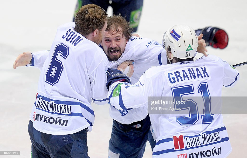 Alexei Tsvetkov #9 f (C) celebrates after Dinamo Moscow defeats Traktor Chelyabinsk at the final play-off game during the KHL Championship 2012/2013 on April 18, 2013 at the Arena Traktor in Chelyabinsk, Russia.