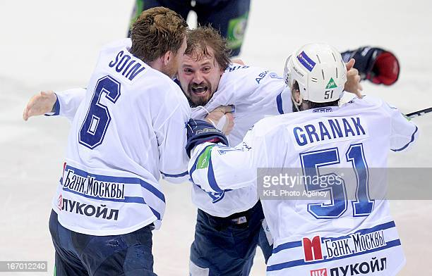Alexei Tsvetkov f celebrates after Dinamo Moscow defeats Traktor Chelyabinsk at the final playoff game during the KHL Championship 2012/2013 on April...