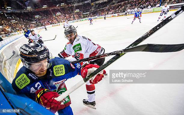 Alexej Dmitriev of Duesseldorf and Frederik Eriksson of Koeln in action during the DEL match between Duesseldorfer EG and Koelner Haie at ISS Dome on...