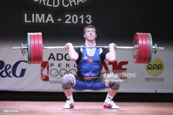 Alexey Kosov of Russia A competes in Men's 94kg during day six of the 2013 Junior Weightlifting World Championship at Maria Angola Convention Center...