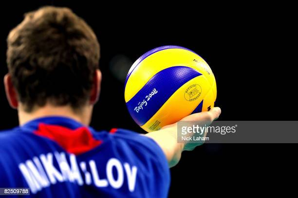 Alexey Kuleshov of Russia prepares to serve while taking on the United States during the semifinal volleyball game at the Capital Indoor Stadium on...