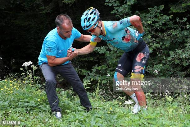 Alexey Lutsenko of Kazakhstan riding for Astana Pro Team is helped up after crashing during stage 9 of the 2017 Le Tour de France a 1815km stage from...