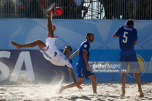 Alexey Makarov of Russia attempts a scissor kick shot on goal in front of Francesco Corosiniti and Alessio Frainetti during the FIFA Beach Soccer...