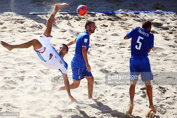 Alexey Makarov of Russia does a scissor kick next to Francesco Corosiniti and Alessio Frainetti of Italy during the FIFA Beach Soccer World Cup...