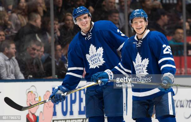 Alexey Marchenko and Nikita Soshnikov of the Toronto Maple Leafs smile while playing the Detroit Red Wings during the first period at the Air Canada...