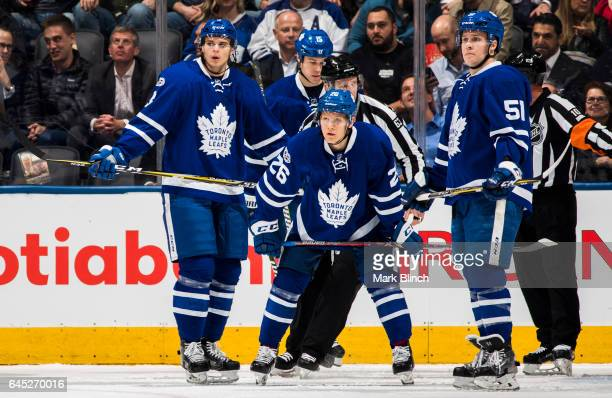 Alexey Marchenko Matt Martin Nikita Soshnikov and Matt Martin of the Toronto Maple Leafs stand in a break against the New York Rangers during the...