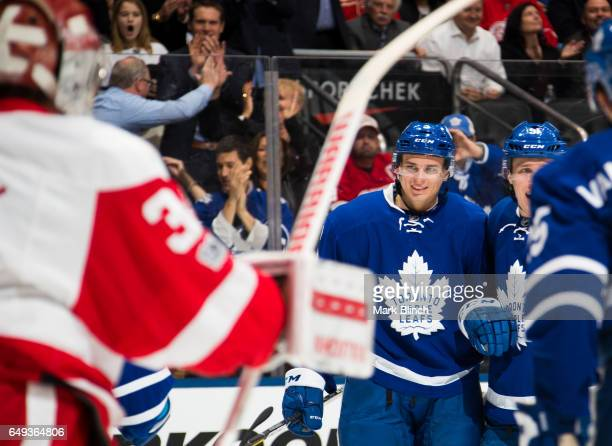 Alexey Marchenko of the Toronto Maple Leafs celebrates his goal on Petr Mrazek of the Detroit Red Wings with teammates Jake Gardiner and James van...