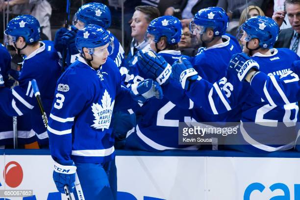 Alexey Marchenko of the Toronto Maple Leafs celebrates his goal against the Detroit Red Wings with teammates during the first period at the Air...