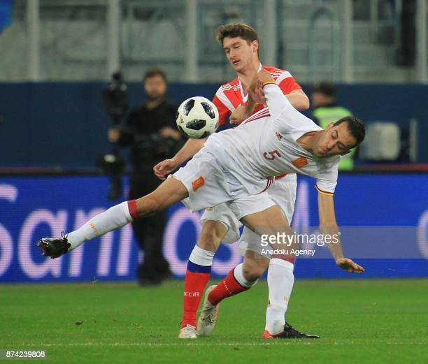 Alexey Miranchuk of Russia in action against Sergio Busquets of Spain during an international friendly football match between Russia and Spain at...