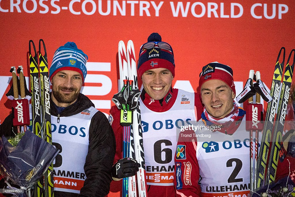 Alexey Petukhov of Russia Paal Golberg of Norway and Finn Haagen Krogh of Norway pose on the podium after the Men 15 km Sprint free at Birkebeineren...