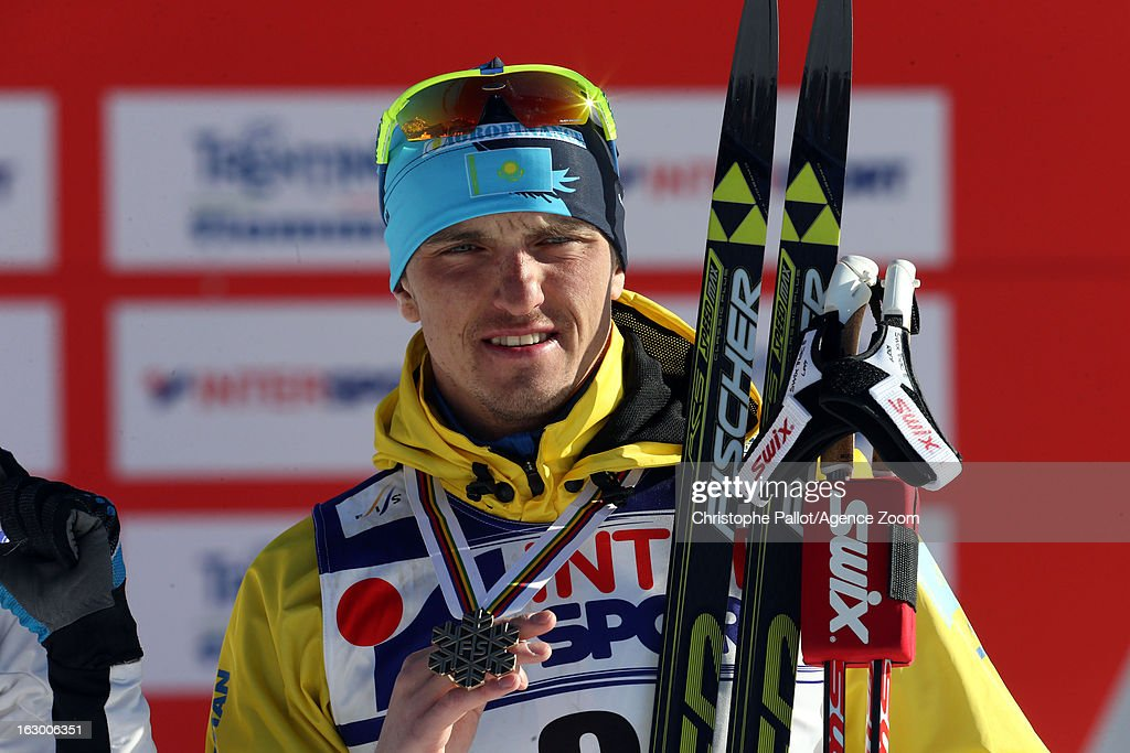 Alexey Poltaranin of Kazakstan takes the bronze medal competes during the FIS Nordic World Ski Championships Cross Country Men's Mass Start on March 03, 2013 in Val di Fiemme, Italy.