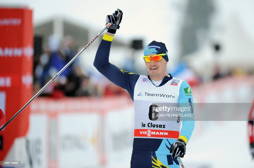 Alexey Poltoranin of Kazakhstan crosses the finish line at the end of the men's World Cup Nordic skiing cross country 15km Mass Start race, on January 19, 2013, in La Clusaz,southern France. AFP PHOTO / Jean Pierre Clatot
