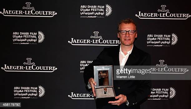 Alexey Serebryakov poses with his JaegerLeCoultre Best Actor award in the Narrative category for the film Leviathan directed by Andrey Zvyagintsev at...