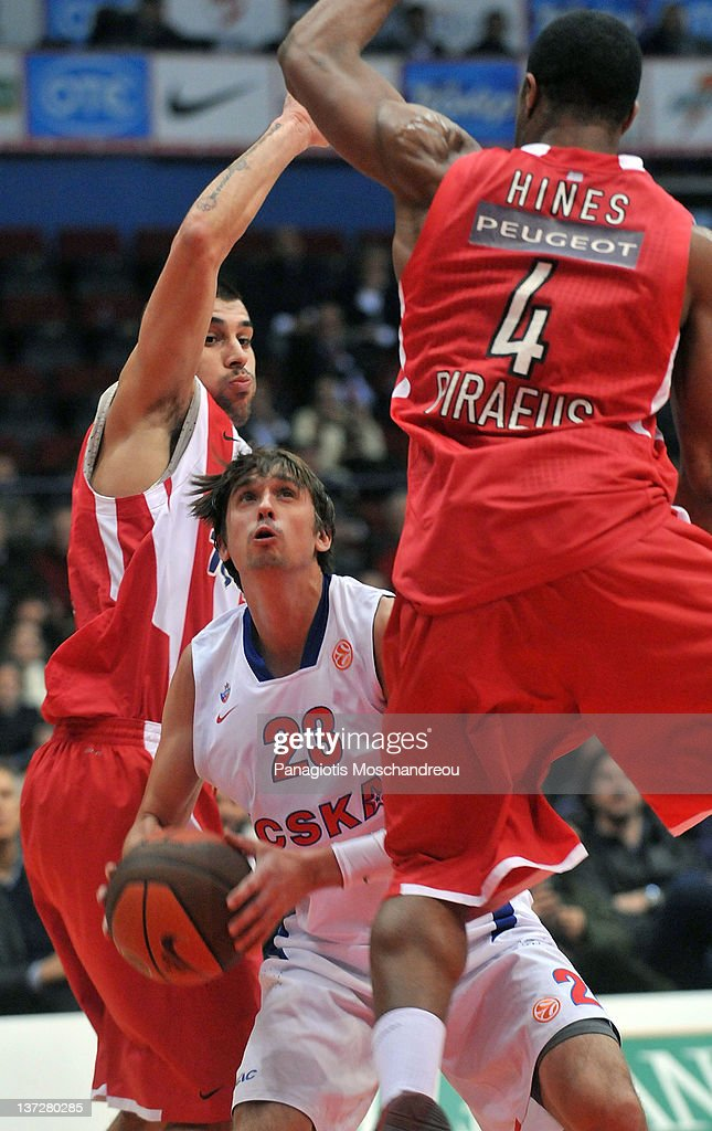 <a gi-track='captionPersonalityLinkClicked' href=/galleries/search?phrase=Alexey+Shved&family=editorial&specificpeople=5557761 ng-click='$event.stopPropagation()'>Alexey Shved</a>, #23 of CSKA Moscow competes with Georgios Printezis, #15 of Olympiacos Piraeus in action during Turkish Airlines Euroleague TOP 16 Game Day 1 between Olympiacos Piraeus v CSKA Moscow at Peace and Friendship Stadium on January 18, 2012 in Athens, Greece.