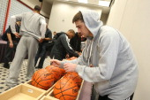 Alexey Shved and Isaiah Thomas of Team Chuck autograph balls before the BBVA Rising Stars Challenge Practice in Sprint Arena during the 2013 NBA Jam...